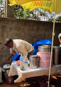 Seetharam serving neer dosa behind Maharaja college in the city of Mysore