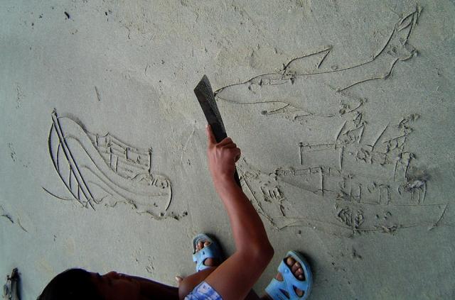Oswald drawing a scene of Indian Coast Guard chasing a Burma poachers