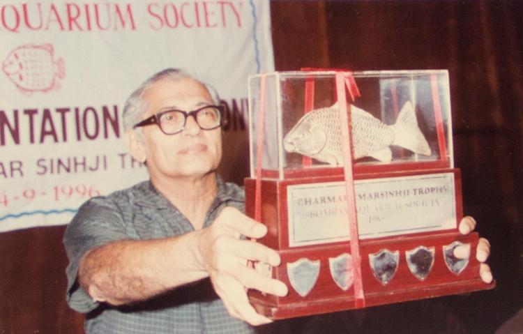 Dr. Chhapagar receiving Dharmakumarsinhji Trophy for ornamental fish keeping.